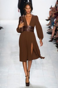 Michael Kors held a classic society safari soiree. Blue tones (think slate, sky, and dark denim) paired with python, jungle green, and khaki. It was clean, classic, and, as always, impeccably tailored. Mr. Kors truly understands the female form.